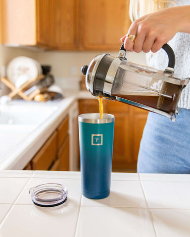 Woman pouring coffee into Iron Flask Tumbler