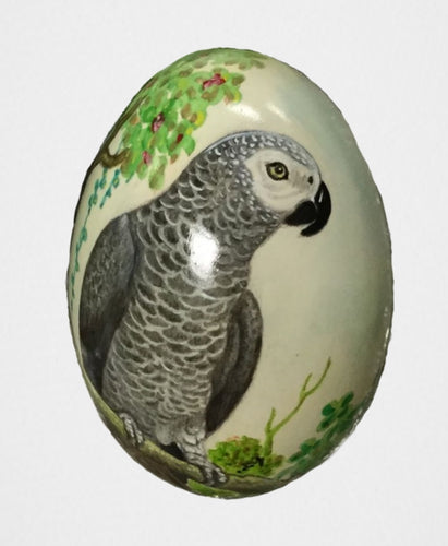 African Grey parrots hand-painted onto a decorative swan egg