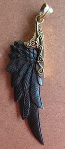 Hand-carved black bone wing pendant jewelry