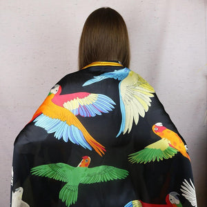 Beautiful parrot-themed evening scarf featuring a variety of parrots. Buttery-soft feel!