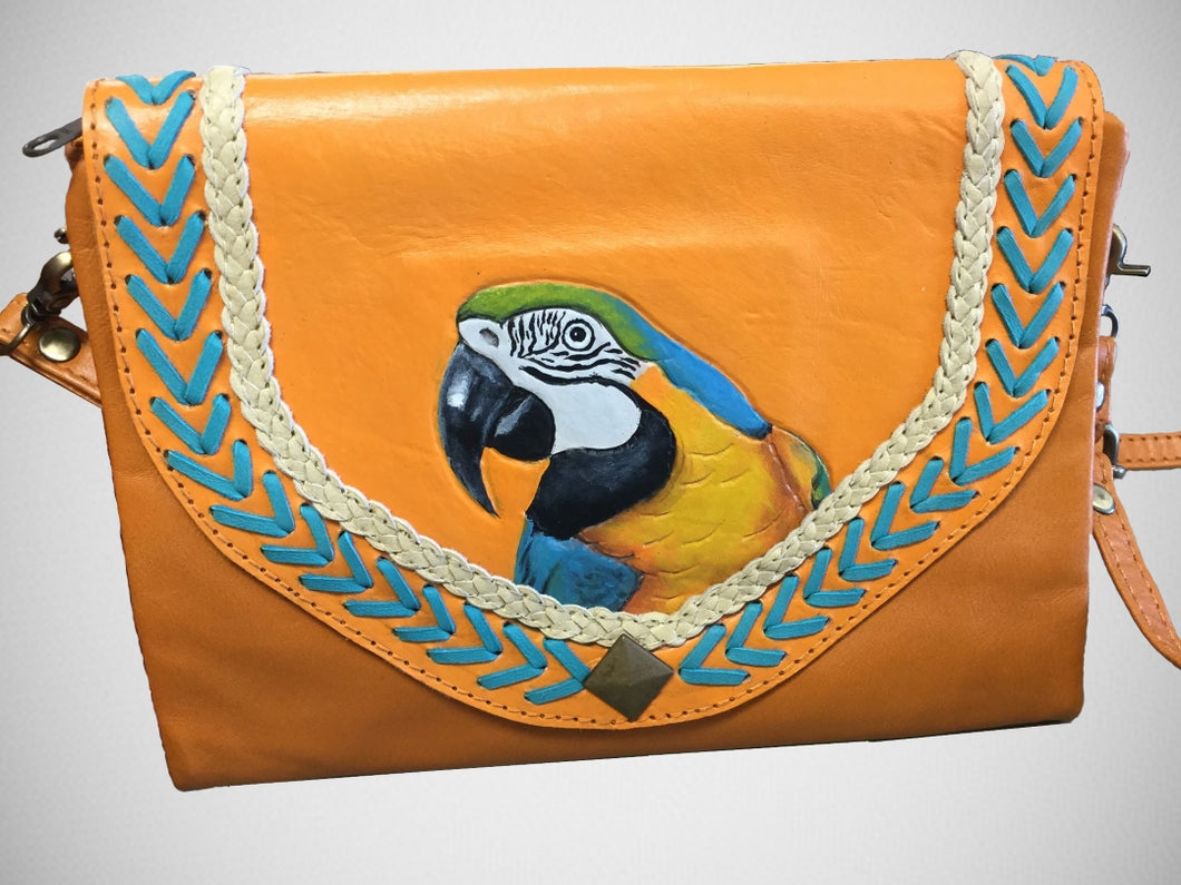 Blue & yellow macaw hand-tooled, hand-painted leather clutch in butterscotch color