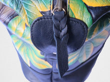 Detail on the African Grey Parrot hand-tooled, hand-painted leather bag