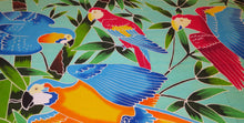 Close-up of flying macaws hand-painted batik sarong