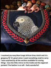 Customer's pic and review of African Grey hand-tooled hand-painted leather clutch