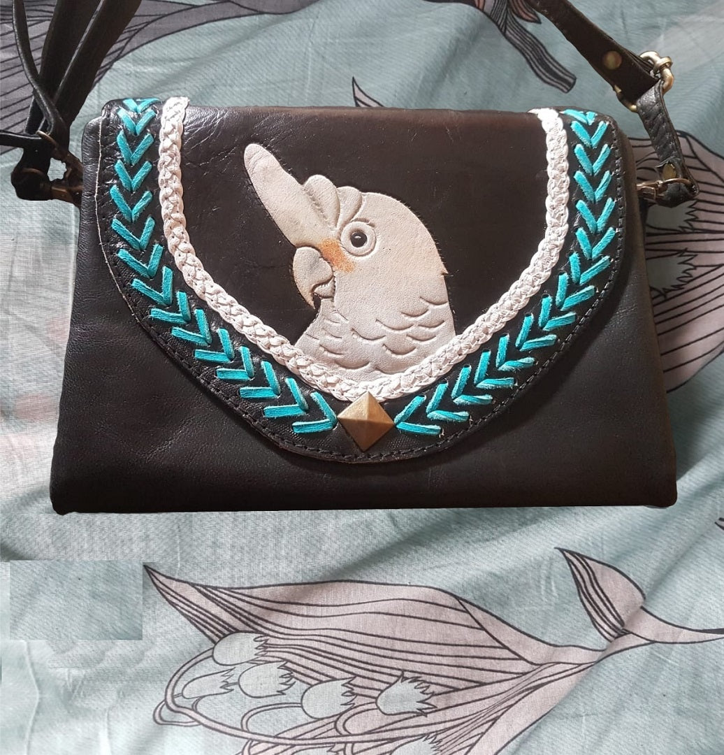 Goffin's cockatoo parrot hand-tooled, hand-painted leather clutch purse with cross-body strap on black leather