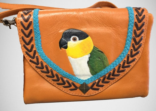 Black-headed caique hand-tooled, handpainted leather clutch in natural/brown/teal