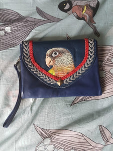 Hand-tooled hand-painted women's clutch purse wallet of a Pineapple conure in navy blue leather