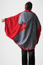 African Grey parrot hand-painted batik sarong worn as a jacket - back view with red background