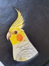 Lutino cockatiel hand-tooled hand-painted leather clutch in progress