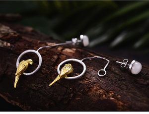 Hand-crafted sterling silver parrot drop earrings