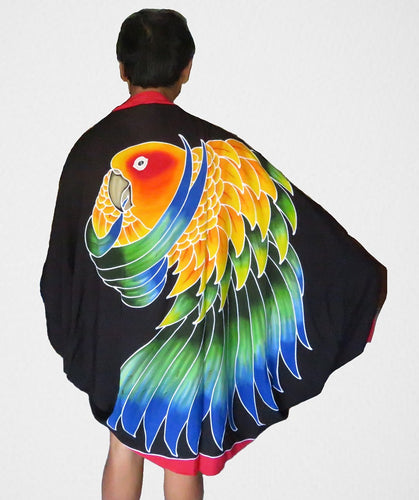 Sun Conure hand-painted batik sarong worn as a jacket