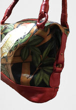 End view of the Moluccan cockatoo hand-tooled, hand-painted leather bag
