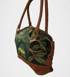 3/4 view of DYH Amazon hand-tooled, handpainted leather bag