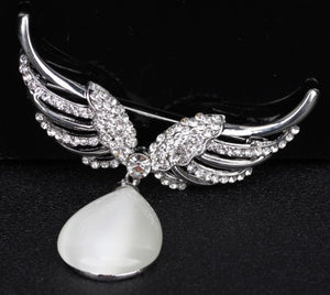 Angel wing brooch with crystal stones and an opal