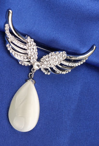 Parrot wing brooch with an opal and crystal stones