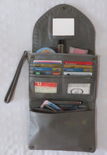 Lots of room and features to help keep you organized in this leather clutch