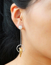 Sterling silver, hand-made parrot drop earrings worn by the model
