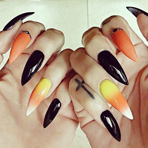 Best Black Stiletto Nails Designs For Your Halloween; Black nails; black stiletto nails; black and white; stiletto nails; long nails; nails addict; nails magazine; gothic nails; Halloween nails