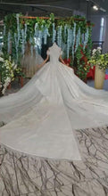 Load and play video in Gallery viewer, Ostty White Ball Gown Tulle Appliques Long Sleeve Wedding Dress With Train OS0329