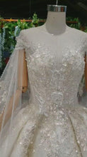 Load and play video in Gallery viewer, Ostty White Ball Gown Tulle Appliques Long Sleeve Wedding Dress With Train OS0327