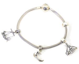 bracelet with set of the three Galilean Boats charms, the Magdala bracelet and one stopper is the complete reference of the boats in the times of Jesus in the Sea of Galilee
