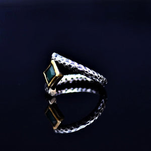 Silver Ring Adorned With Lab Created Emerald Stone