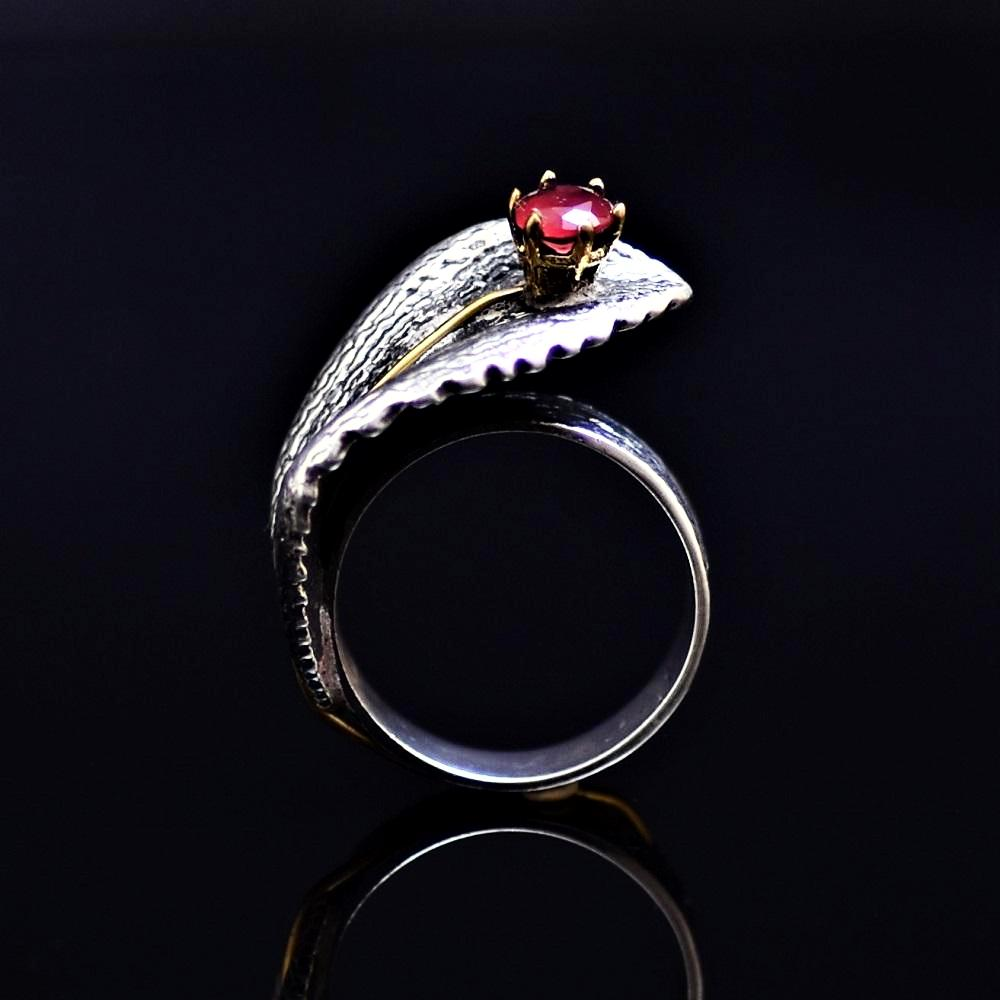 Silver Ring Adorned With Lab Created Ruby Stone