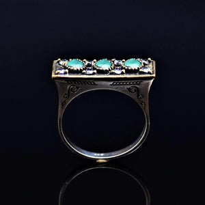 Silver Ring Adorned With Lab Created Emerald And White Zircon Stones