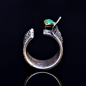 Silver Ring Adorned With An Emerald Stone