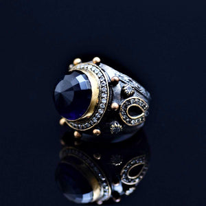 Silver Ring Adorned With A Big Blue Zircon Stone And Zirconia Stones