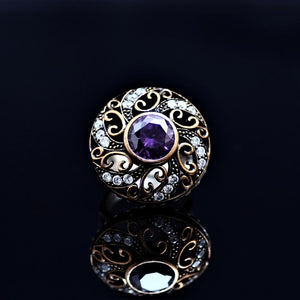 Silver Ring Adorned With Amethyst And Little Zirconia Stones