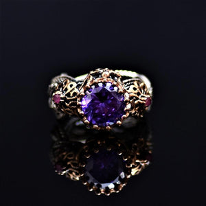 Silver Ring Adorned With Amethyst And Little Ruby Stones