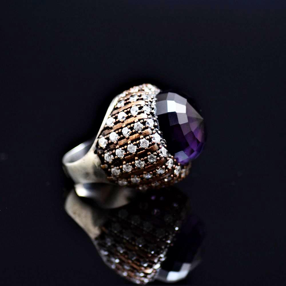 Silver Ring Adorned With A Big Facet Cut Amethyst Stone