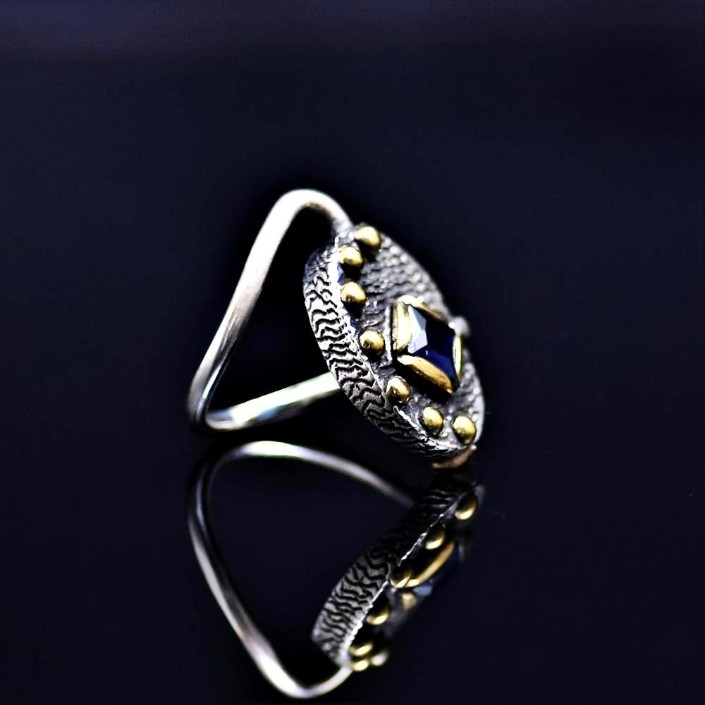 Silver Ring Adorned With Lab Created Sapphire Stone