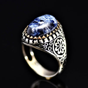 Beautiful Ring Adorned With Natural Stone And Engraved Flower Motifs