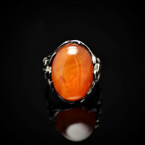 Big Silver Ring Adorned With Orange Colored Agate Stone Front