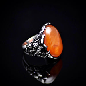 Big Silver Ring Adorned With Orange Colored Agate Stone Left