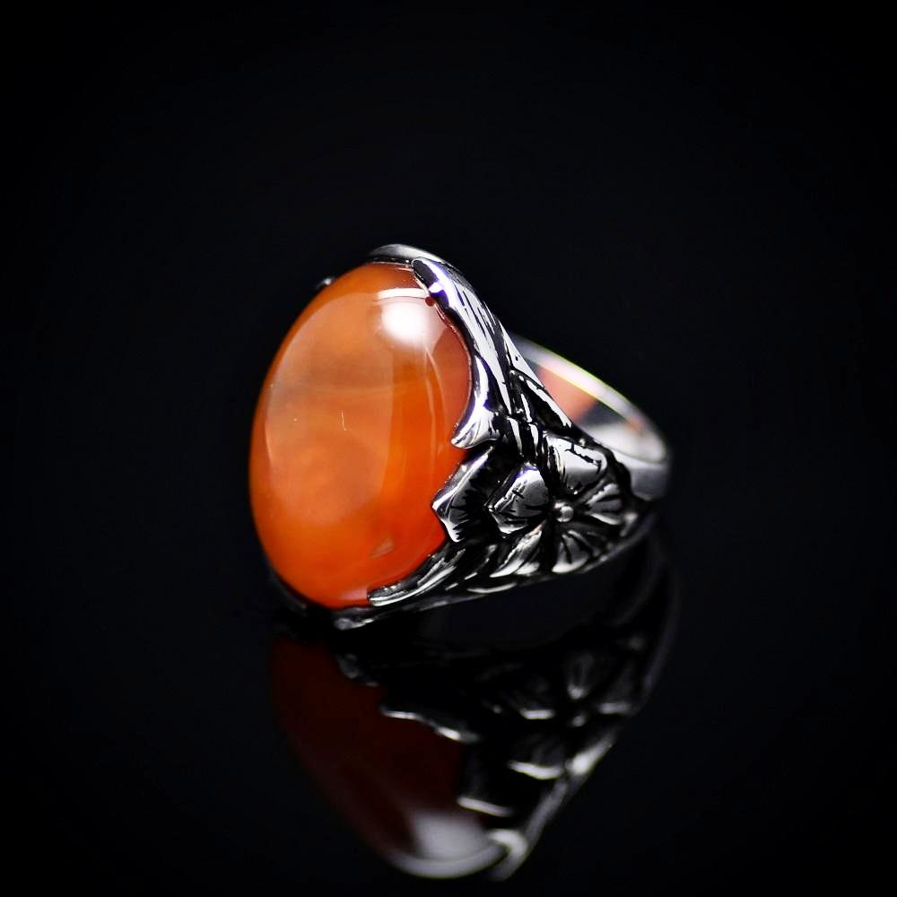 Big Silver Ring Adorned With Orange Colored Agate Stone Right