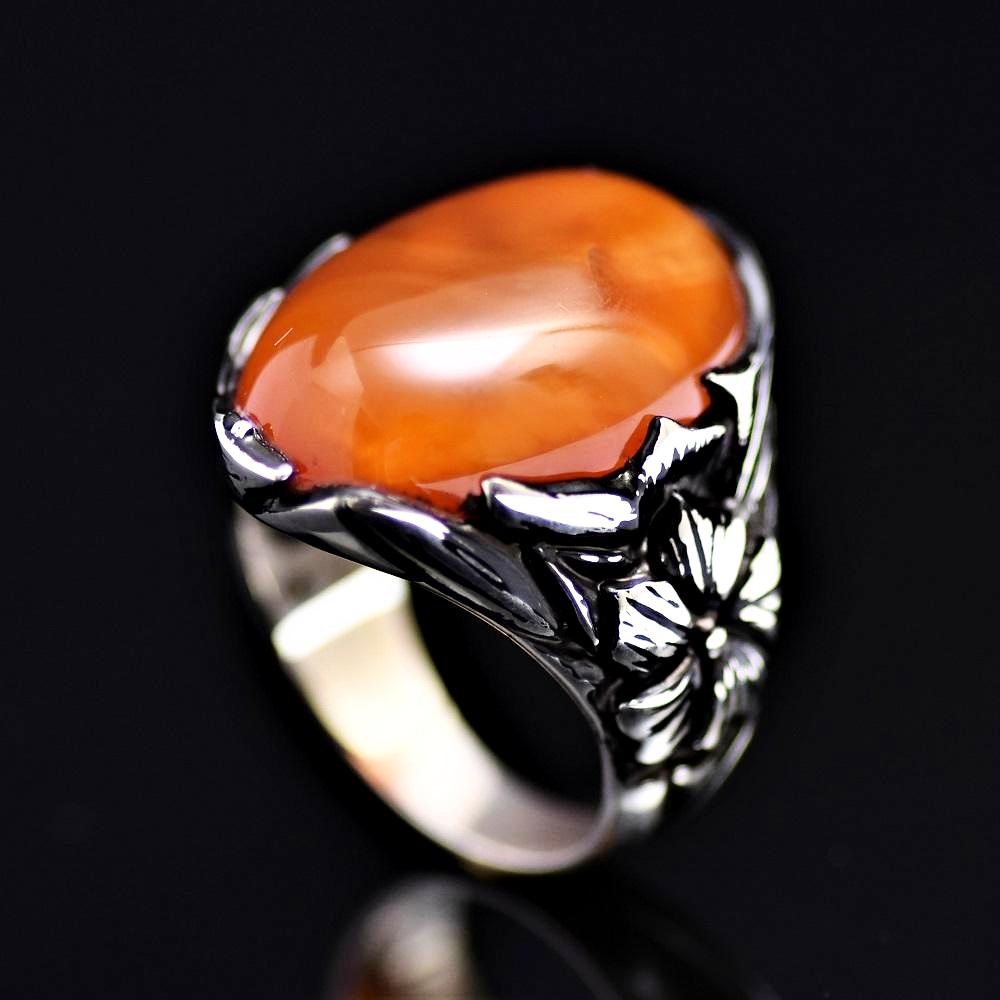 Big Silver Ring Adorned With Orange Colored Agate Stone