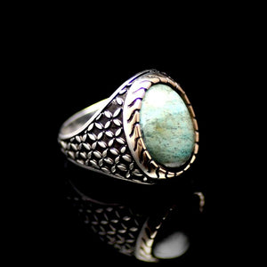 Distinctive Silver Ring Adorned With A Natural Stone Left