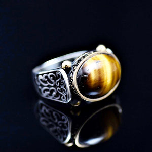 Elegant Sterling Silver Ring Adorned With Tiger Eye Stone Left