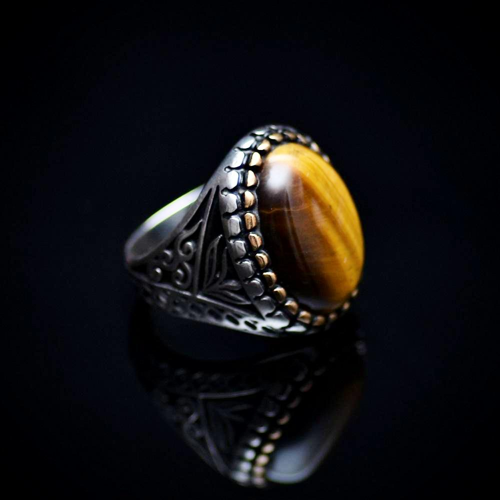 Engraved Silver Ring Adorned With A Tiger's Eye Stone Left