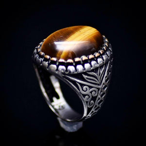 Engraved Silver Ring Adorned With A Tiger's Eye Stone