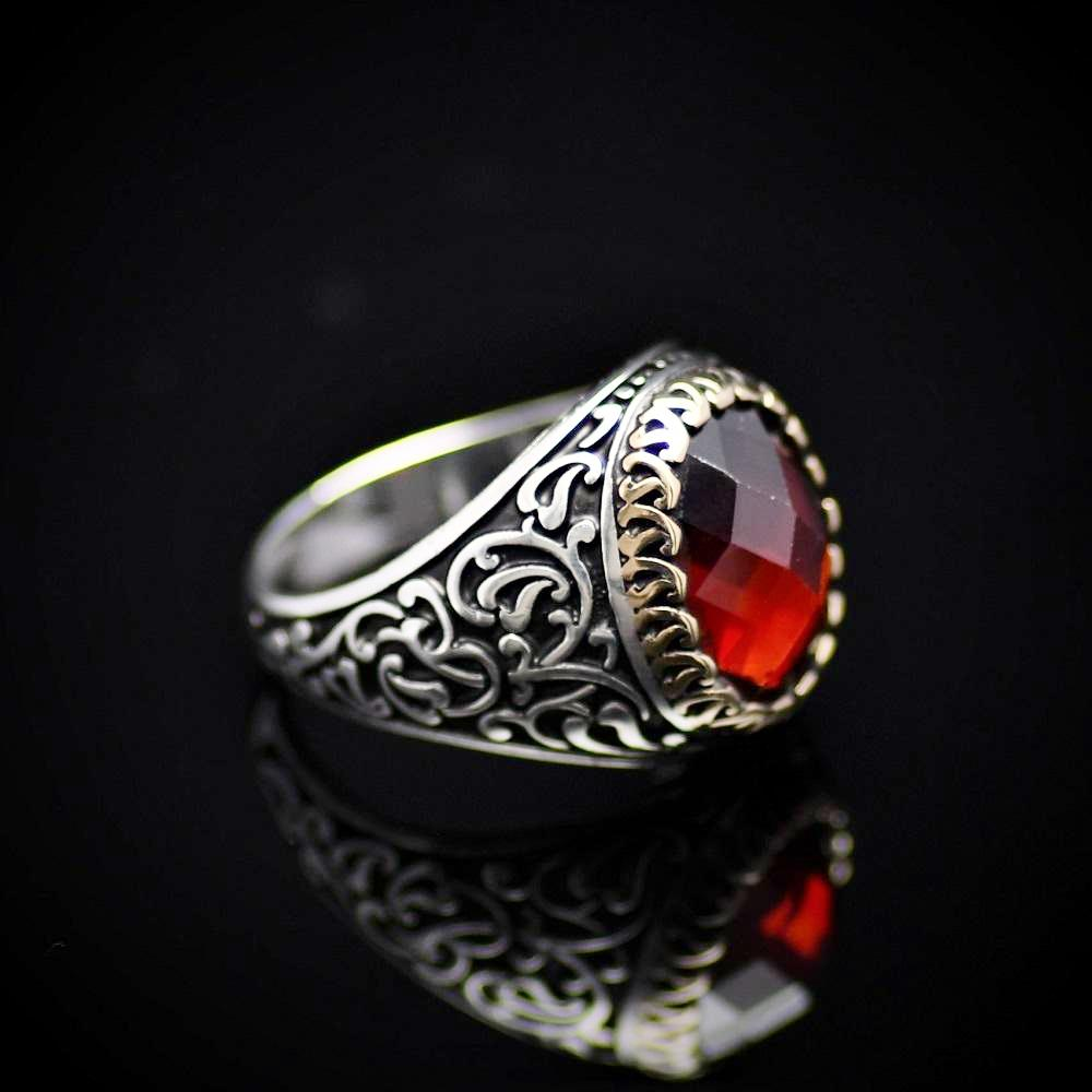 Finely Detailed Handmade Silver Ring With Garnet Stone Left