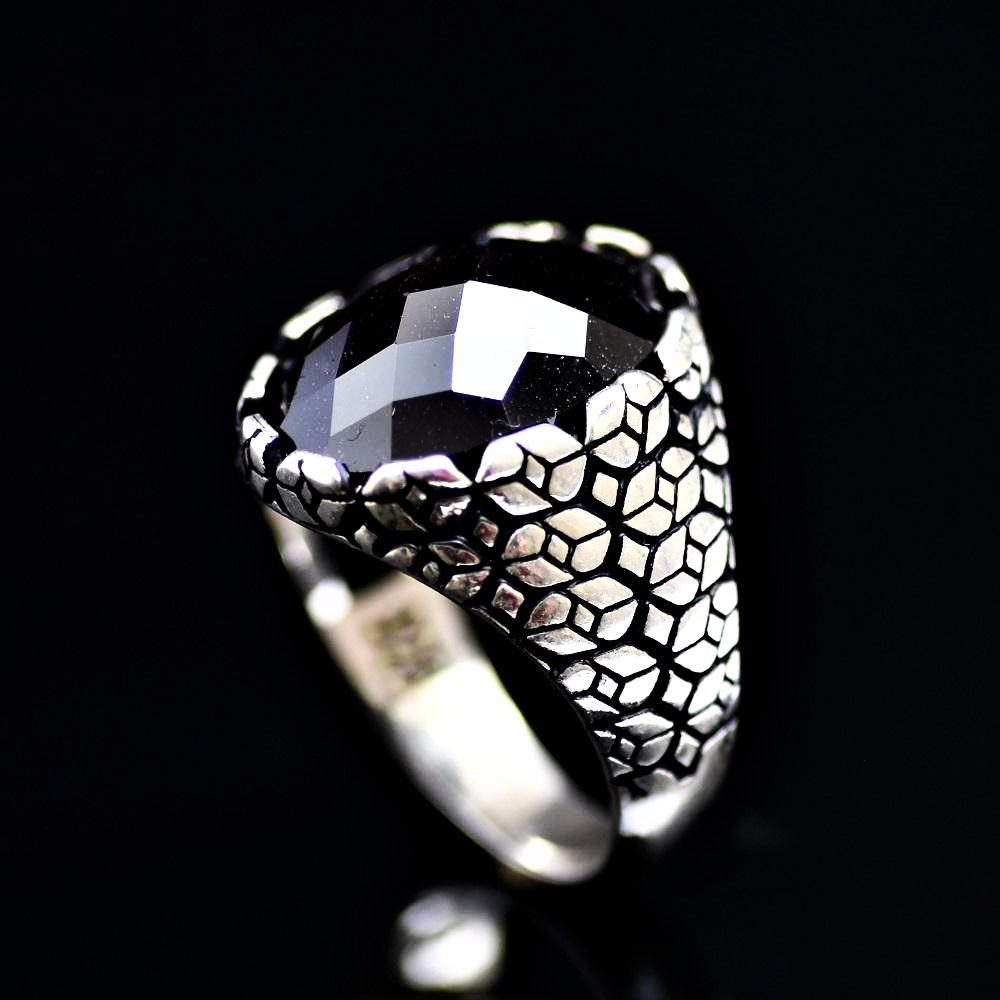 Geometric Shapes Designed Silver Ring Adorned With Garnet Stone