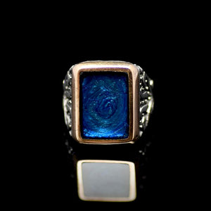 Sophisticated Silver Ring Adorned With Blue Enamel Front