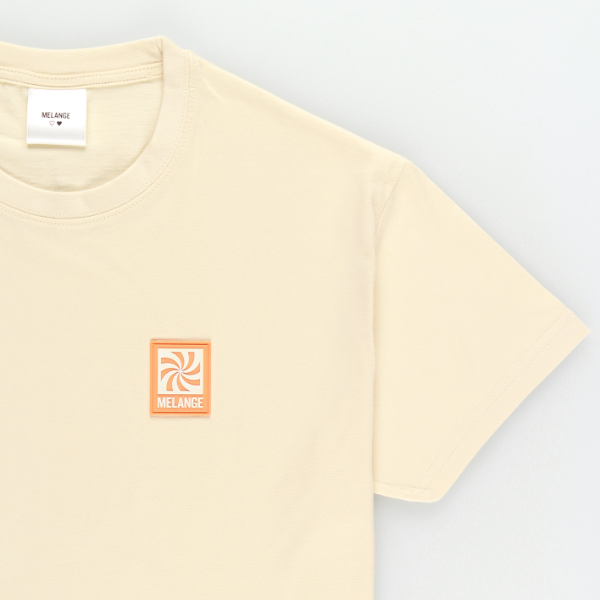 MELANGE - Cream T-shirt Orange Spiral Logo