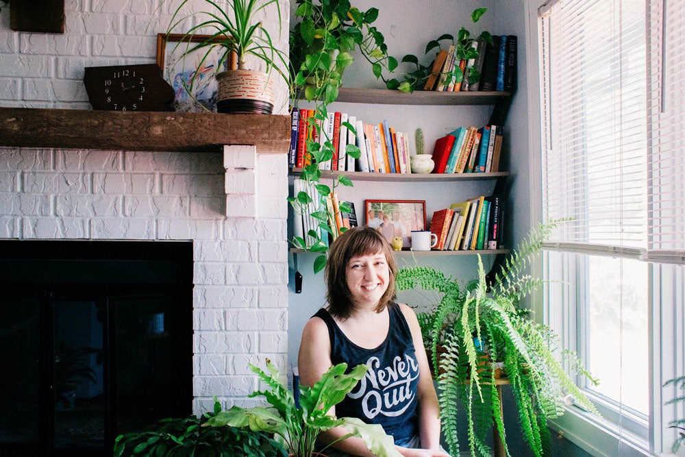Andrea in her home with plants