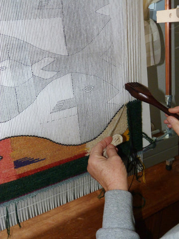 fish tapestry being woven