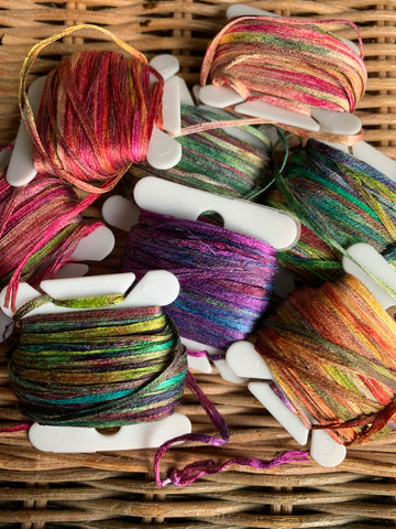 Hand-painted silk on bobbins